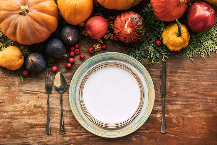 Healthy autumn eating with top view of table setting with a selection of autumnal fruits and vegetables